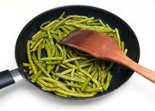 Fried green beans. On pan royalty free stock images