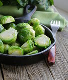 Fried green brussels sprouts Stock Photos