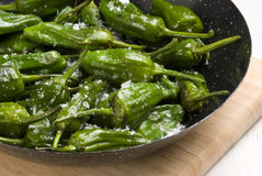 Fried green peppers. Royalty Free Stock Images