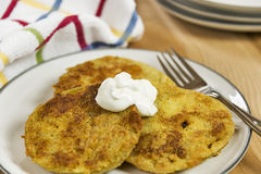 Fried green tomatoes topped with a dollop of sour cream royalty free stock photo