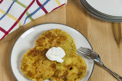 Fried green tomatoes topped with a dollop of sour  Stock Photos