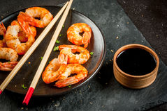 Fried grilled shrimp prawns with soy sauce Royalty Free Stock Photos