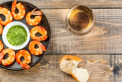 Fried grilled shrimp prawns with white wine. Seafood. Shellfish. Fried grilled shrimp prawns on a plate, with a sauce of olive oil and fresh herbs, with fresh Stock Image