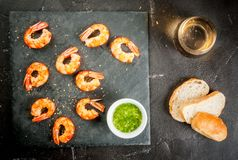 Fried grilled shrimp prawns with white wine Stock Image