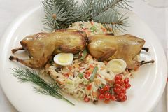 Fried Grouse in a plate served on a festive New Year royalty free stock photos