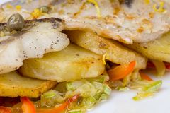 Fried haddock and vegetables Stock Photo