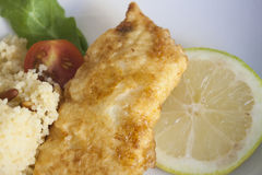 Fried hake with cous cous Royalty Free Stock Image