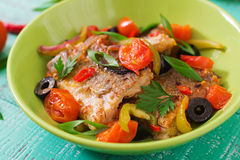 Fried hake fillet with tomato and olives Stock Photos