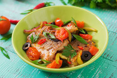 Fried hake fillet with tomato and olives Stock Photography