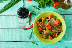 Fried hake fillet with tomato and olives Royalty Free Stock Image