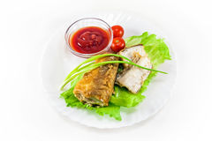 Fried hake with tomatoes Royalty Free Stock Photos