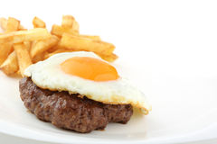 Fried hamburger and egg isolated Stock Photo