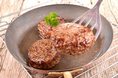 Fried hamburger meat in a copper pan Royalty Free Stock Images