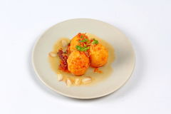 Fried hard-boiled eggs with tamarind sauce . Popular Thai food,fried hard-boiled eggs with tamarind sauce call as Khai Luk Keoi in Thai ,which mean egg gift Stock Photo