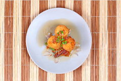 Fried hard-boiled eggs with tamarind sauce . Popular Thai food,fried hard-boiled eggs with tamarind sauce call as Khai Luk Keoi in Thai ,which mean egg gift Stock Image