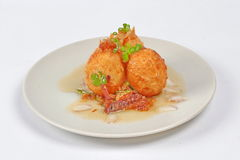 Fried hard-boiled eggs with tamarind sauce . Popular Thai food,fried hard-boiled eggs with tamarind sauce call as Khai Luk Keoi in Thai ,which mean egg gift Stock Photography