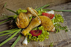 Fried hen in the leaves of lettuce on a board Royalty Free Stock Photography