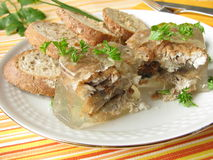 Fried herring into aspic Stock Photos
