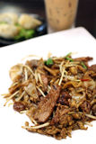 Fried Hor Fun (Rice Noodle). Close up of a dish of fried hor fun (rice noodle) on white plate Royalty Free Stock Photos