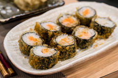 Fried hossomaki sushi rolls with fresh raw salmon and white rice Royalty Free Stock Photography