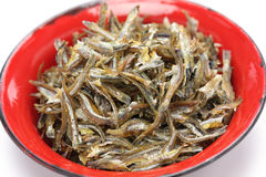 Fried ikan bilis(dried anchovies) , malaysian food. Fried ikan bilis(dried anchovies) in bowl isolated on white background Royalty Free Stock Photos