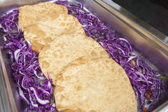 Fried indian naan bread at a restaurant buffet Royalty Free Stock Image