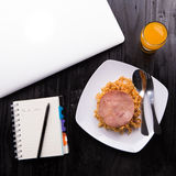 Fried Indonesian Noodle with ham and orange juice. Food while working Royalty Free Stock Photos