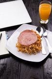 Fried Indonesian Noodle with ham and orange juice. Food while working Stock Photography