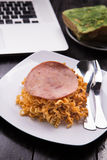 Fried Indonesian Noodle with ham and orange juice. Food while working Stock Photo