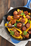 Fried Italian sausage with sweet peppers and onions Stock Image