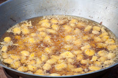 Fried jackfruit cooking in pan Stock Images