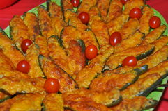 Fried jalapenos. With cheese and tomatoes Royalty Free Stock Image
