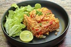 Fried Jasmine rice with prawns in yellow powder Stock Photo
