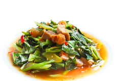 Fried kale with crispy pork, Thai food. Royalty Free Stock Photo