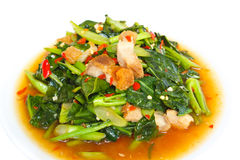 Fried kale with crispy pork, Thai food. Royalty Free Stock Photography