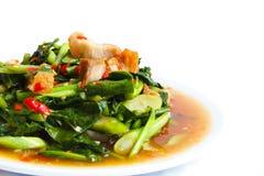 Fried kale with crispy pork, Thai food. Royalty Free Stock Photos
