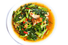Fried kale with crispy pork, Thai food. Stock Photography