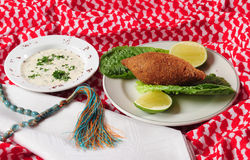 Fried Kibe. Middle eastern cuisine. Fried balls of bulgar wheat and mincemeat with vegetables and dip Royalty Free Stock Photos