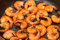 Fried King Prawns in a Frying Pan Stock Photo