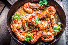 Fried king prawns with garlic and coriander Royalty Free Stock Images