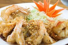 Fried king prawns with garlic and herbs Royalty Free Stock Images