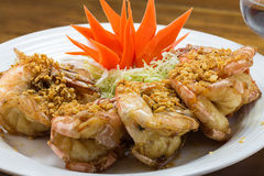 Fried king prawns with garlic and herbs Royalty Free Stock Photo