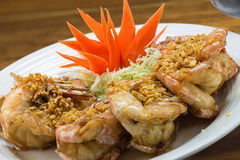 Fried king prawns with garlic and herbs Stock Photos