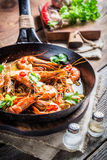 Fried king prawns with garlic and red peppers Stock Photography