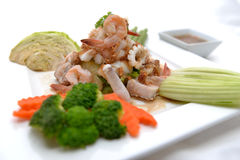 Fried king prawns and squid with garlic and herbs Royalty Free Stock Photography
