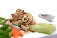 Fried king prawns and squid with garlic and herbs Stock Images