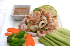 Fried king prawns and squid with garlic and herbs Stock Photo