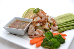 Fried king prawns and squid with garlic and herbs Stock Photos
