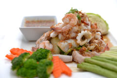Fried king prawns and squid with garlic and herbs Stock Image
