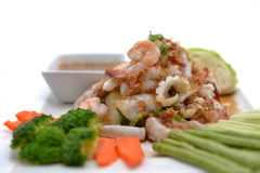 Fried king prawns and squid with garlic and herbs Royalty Free Stock Photos